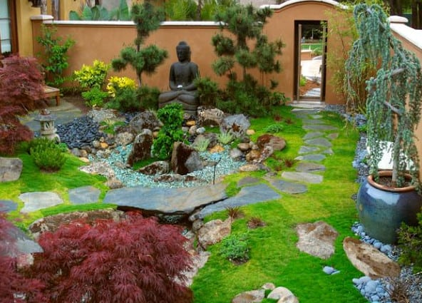 japanese garden with statue of Buddha